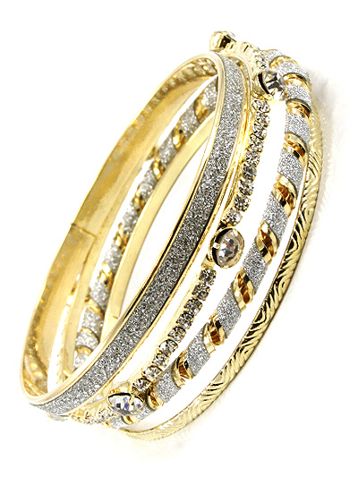 FOUR LAYERED GOLD TONE BANGLED W/ VARIOUS PATTERNS AND ACCENTS BRACELET
